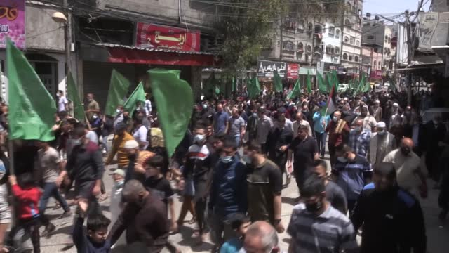 palestinians stage a protest against israeli violences toward palestinians in jerusalem and the decision to postpone palestinian elections in gaza... - israel stock videos & royalty-free footage