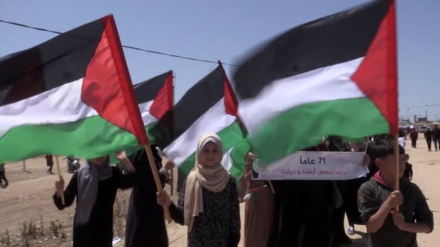 palestinians take part in a demonstration to mark the 71st anniversary of the palestinian nakba near the gaza-israel buffer zone on may 10, 2019 in... - historical palestine stock videos & royalty-free footage
