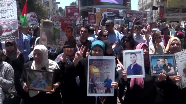 palestinians take part in a rally in support of israeliheld palestinian prisoners who ended their hunger strike earlier in the day on may 27 2017 in... - prisoner icon stock videos & royalty-free footage