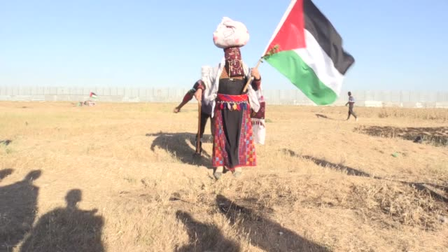 palestinians take part in ongoing rallies against israel's decades-long occupation along the gaza-israel buffer zone on may 10, 2019 in gaza strip.... - historical palestine stock videos & royalty-free footage