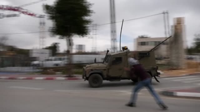 palestinians throw stones at israeli law enforcement vehicles during a demonstration in hebron against israel's plan to annex parts of the west bank - israel palestine conflict stock videos & royalty-free footage