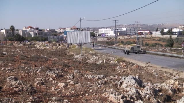 palestinians throw stones the israeli security forces during the protest against the jewish settlement construction in aljalzoo region of ramallah... - israelisches militär stock-videos und b-roll-filmmaterial