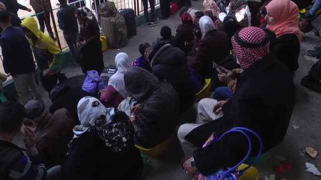 Palestinians wait to cross into Egypt at Rafah border crossing on the border between Egypt and the Gaza Strip in Rafah Gaza on February 13 2016