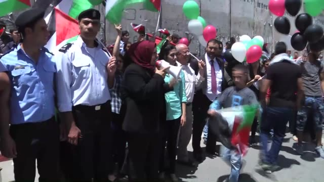 palestinians wave palestinian national flags during a demonstration named keep the flag flying this country's yours organized by palestine youth and... - palestinian flag stock videos & royalty-free footage