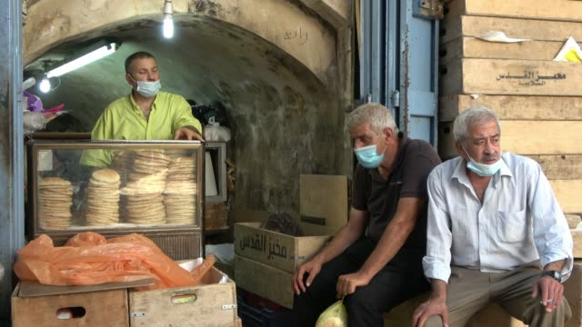 palestinians wearing protective mask due to the coronavirus pandemic on august 28, 2020 in the old city of jerusalem, israel. figures show jerusalem... - jerusalem stock videos & royalty-free footage