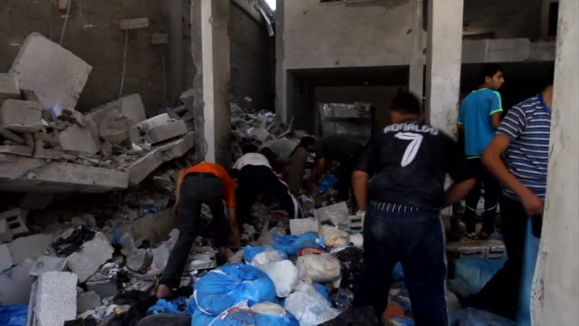 palestinians were searching for goods through the rubble of a destroyed building belonging to a charity organization following an israeli air strike... - rubble stock videos & royalty-free footage
