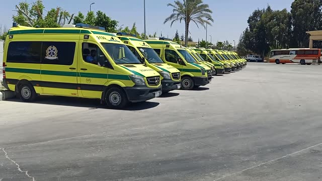 palestinians wounded in the israeli attacks are being brought to rafah crossing point with ambulances to receive treatment at hospitals in egypt in... - gaza strip stock videos & royalty-free footage