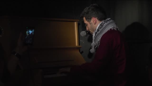 PalestinianSyrian refugee Ayham Ahmad also known as the 'Pianist of Yarmouk Camp' plays piano at a refugee center in Berlin Germany on May 25 2016...
