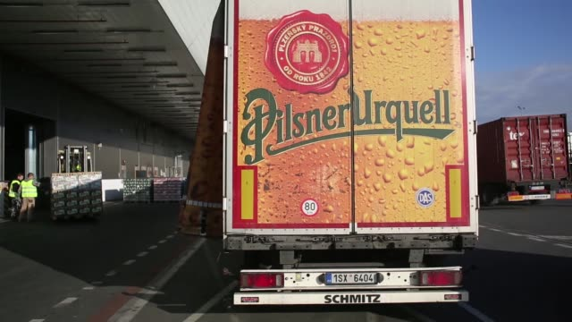 palettes of beer sit in a storage depot at the pilsner urquell brewery operated by sabmiller plc in plzen czech republic on monday dec 7 large copper... - pilsner stock videos & royalty-free footage