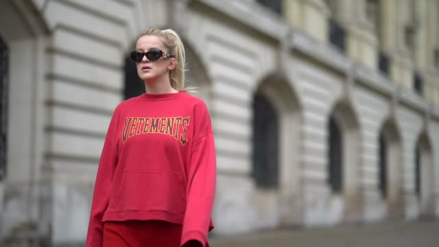 stockvideo's en b-roll-footage met palina kozyrava wears a red vetements pull over red buffalo shoes versace sunglasses outside manish arora during paris fashion week womenswear... - versace modelabel