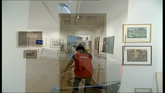 vidéos et rushes de pallant house gallery reopens with collection donated by colin st john wilson wide shots of exhibition room with gallery workers preparing paintings... - colony