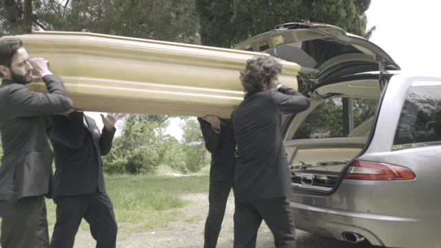 pallbearers arriving with coffin at graveyard - coffin stock videos & royalty-free footage