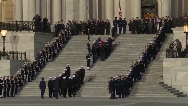 pallbearers carry the casket of george h.w. bush into the us capitol building as the former us president's family look on - funeral stock videos & royalty-free footage