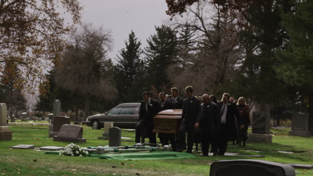 pallbearers carrying coffin to a gravesite - funeral stock videos and b-roll footage