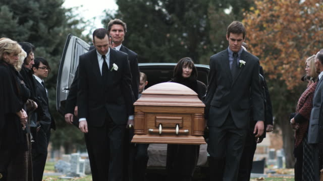 pallbearers carrying coffin  - begräbnis stock-videos und b-roll-filmmaterial