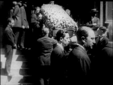 pallbearers carrying rudolph valentino's coffin down stairs / nyc / newsreel - 1926 stock videos & royalty-free footage