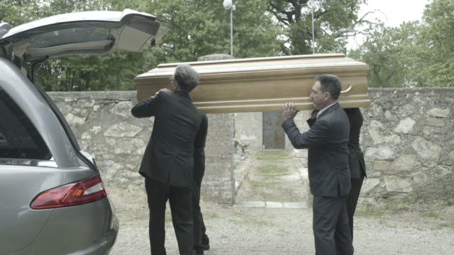 pallbearers in hearse arriving with coffin at graveyard - hearse stock videos & royalty-free footage