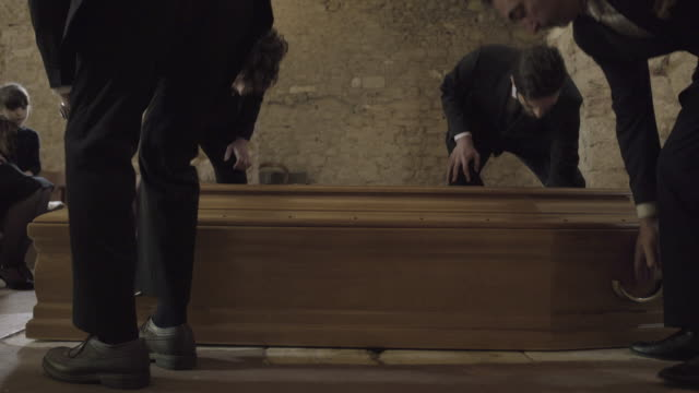 pallbearers leaving church with coffin followed by family - coffin stock videos & royalty-free footage