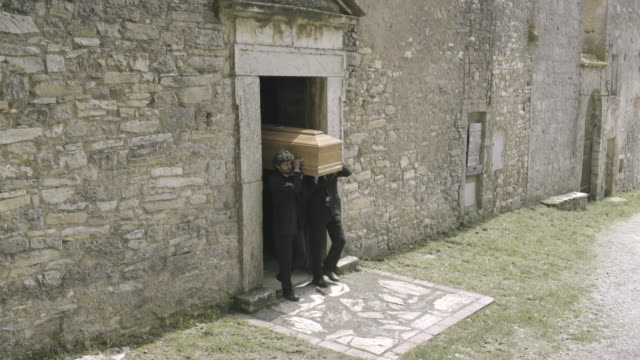 pallbearers leaving church with coffin followed by family - funeral stock videos and b-roll footage