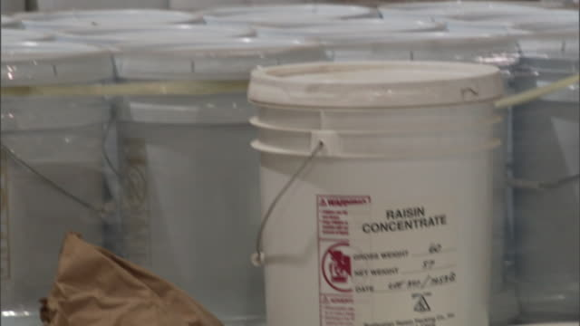 """a pallet of plastic five-gallon pails is marked """"dog fish head"""", from dogfish head craft brewery in delaware - dogfish stock videos & royalty-free footage"""