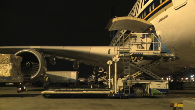 MS Pallets being loaded into cargo hold of Airbus A380 at night, London, United Kingdom