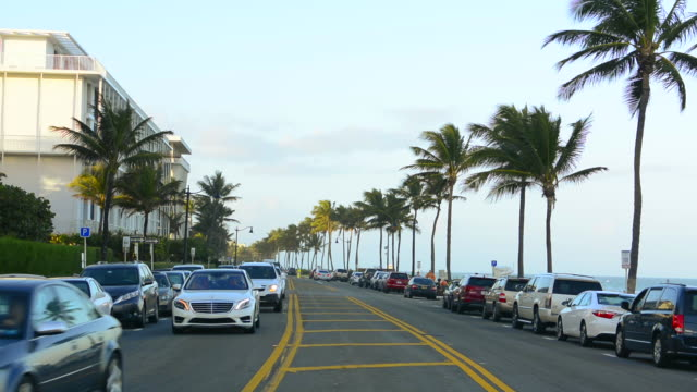Palm Beach Florida Ocean Avenue famous beach on South Ocean Boulevard with palm trees and traffic