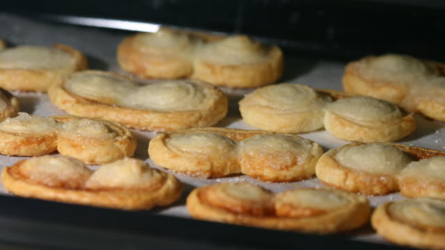 palmiers in the oven, macro shot - french food stock videos & royalty-free footage