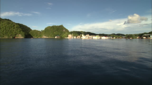 a paluan community nestles on the edge of the philippine sea. - philippine sea stock videos & royalty-free footage