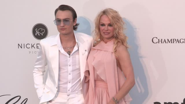 Pamela Anderson and son Brandon Lee at the photocall for the 2019 amfAR in Cannes Cannes France on Thursday May 23 2019