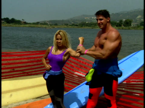 Pamela Anderson and Steve Henneberry flex their muscles
