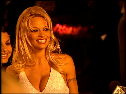 Pamela Anderson at the 1999 Academy Awards Vanity Fair Party at Morton's in West Hollywood California on March 21 1999
