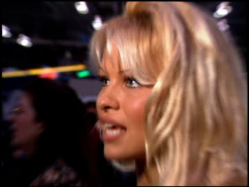 stockvideo's en b-roll-footage met pamela anderson at the natpe convention on january 25, 1995. - natpe convention
