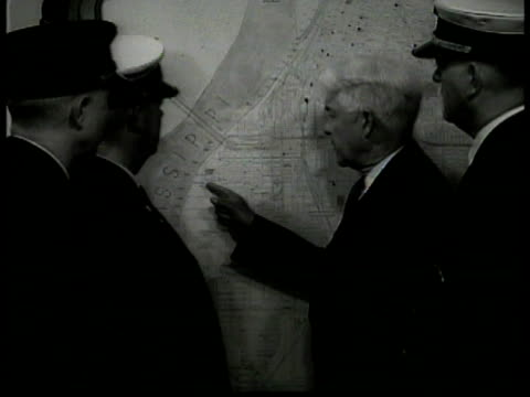 Pamphlet 'Danger in Your Home' Franklin H Wentworth w/ fire officials looking at Memphis wall map MS Firemen getting food at table HA WS Banquet...