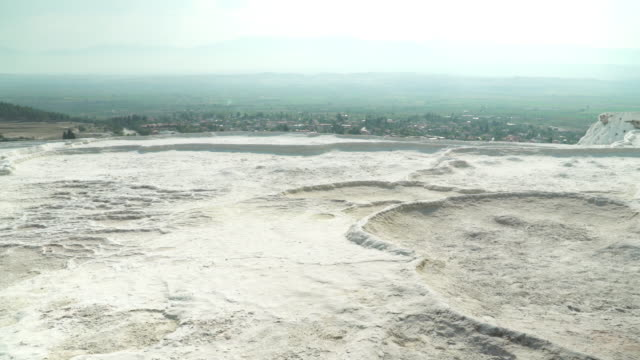 pamukkale pools without flowing water, droughts, in summer. panning view on layers of travertines form terraces of carbonate minerals in pamukkale, natural landmark of natural phenomenon, on sunset at southwest turkey. - natural landmark stock videos & royalty-free footage