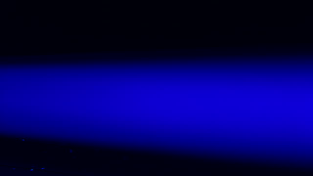 Pan across a blue fluorescent strip light.