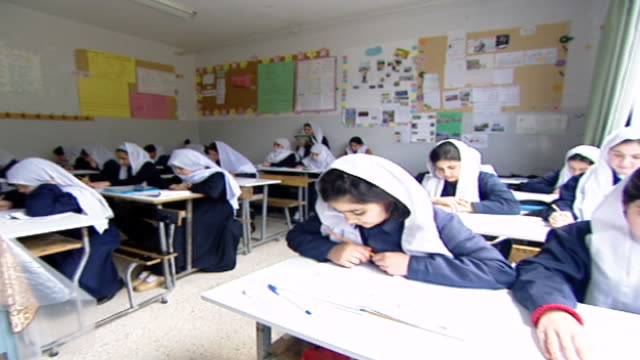 pan across a classroom of druze schoolgirls in traditional attire, to a teacher giving an english class at irfan, a druze religious school in the... - girls stock videos & royalty-free footage