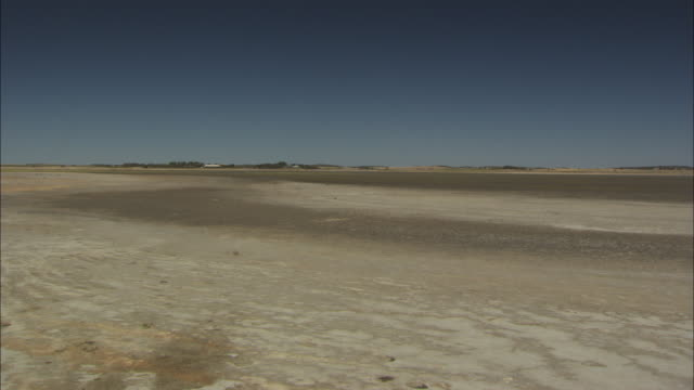 pan across a dried up lake albert in southern australia. - drought stock videos and b-roll footage