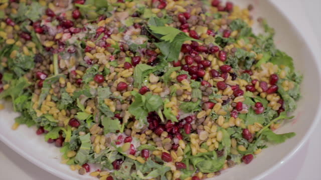 pan across a fresh and healthy salad - quinoa salad stock videos & royalty-free footage