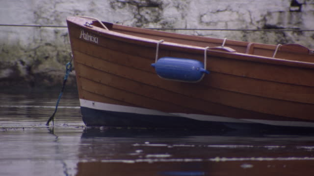 Pan across a motorboat moored at Cobh, County Cork, Ireland.