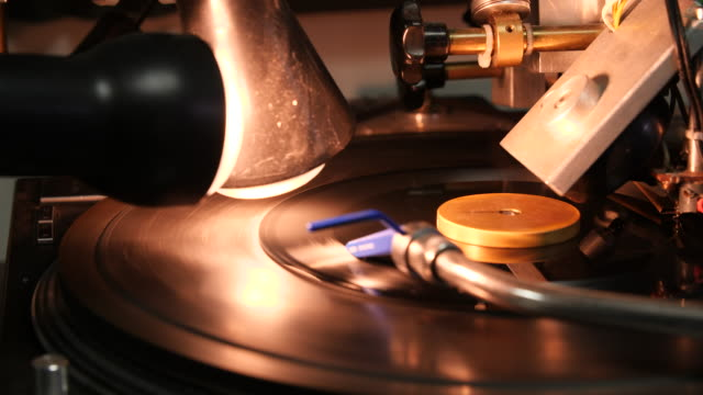 pan across a small vinyl disc rotating on a turntable - electrical equipment stock videos & royalty-free footage