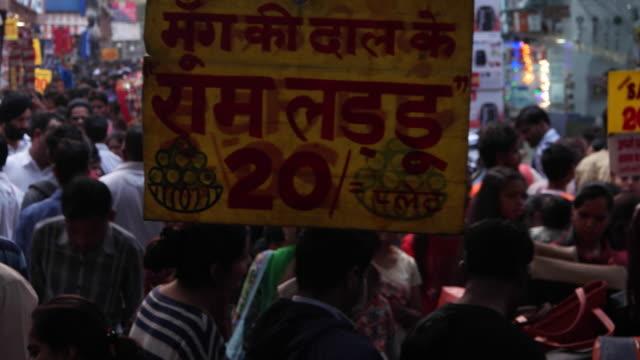 Pan across a very busy market in New Delhi
