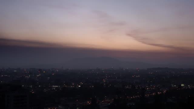 pan across addis ababa at nightfall - アジスアベバ点の映像素材/bロール