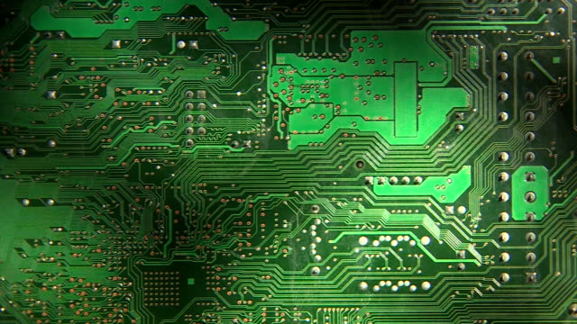 pan across an electronic circuit board. - circuit board stock videos & royalty-free footage