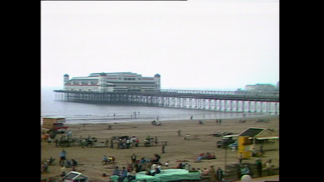 pan across beach to weston super mare pier; 1978 - 1978 stock videos & royalty-free footage