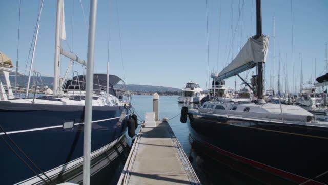 pan across boats in san francisco marina - marina stock videos & royalty-free footage