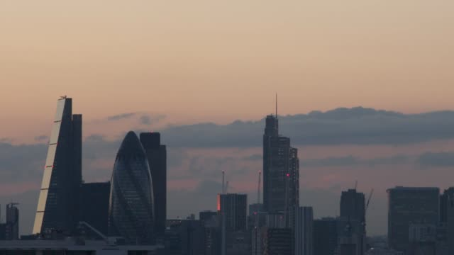 pan across buildings in the city at dusk, uk - skyline stock videos & royalty-free footage