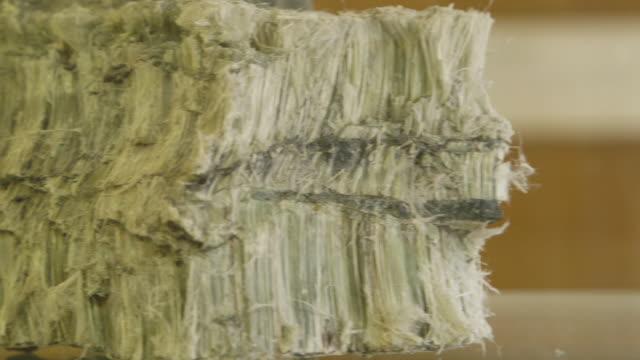 pan across chunk of asbestos, close-up - asbest stock-videos und b-roll-filmmaterial