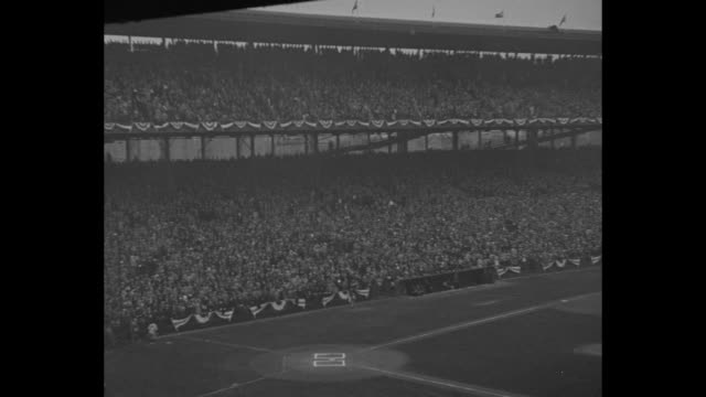 pan across crowd at wrigley field during the third game of the world series / cu new york yankees player babe ruth talking to reporter before game /... - lou gehrig stock videos & royalty-free footage