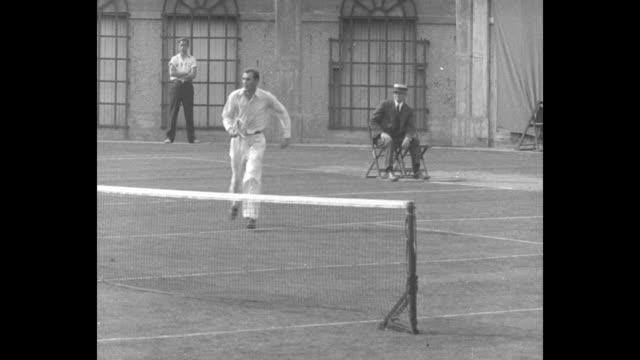 pan across crowd in germantown cricket club stadium to us tennis player bill tilden on court serving at the international lawn tennis challenge /... - davis cup stock videos & royalty-free footage