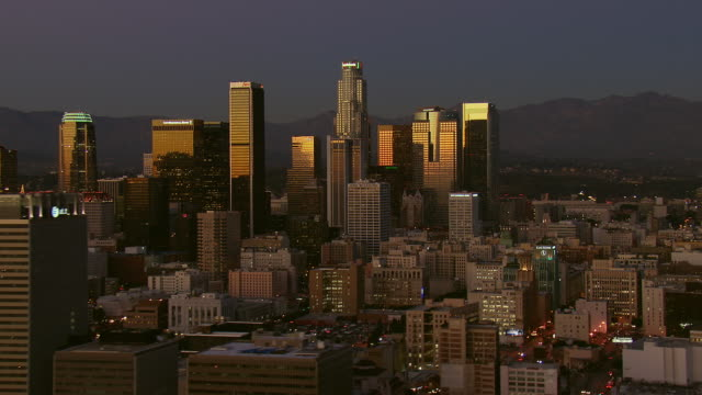 pan across downtown la at dusk - us bank tower stock videos and b-roll footage